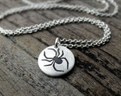 Tiny spider necklace in silver