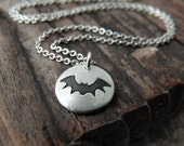 Tiny bat necklace in silver
