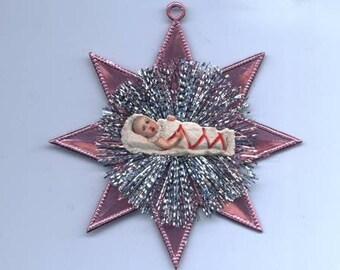 Vintage Scrap Baby Girl and Tinsel Ornament on Pink Dresden Star