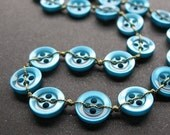 stitched button necklace in ocean blue and green with sterling silver