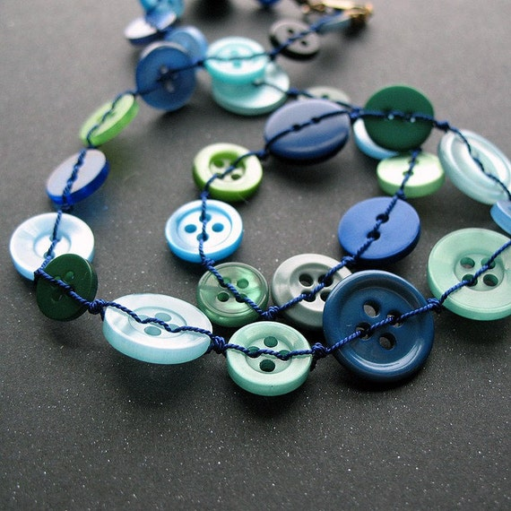 Oceans - stitched button necklace with brass