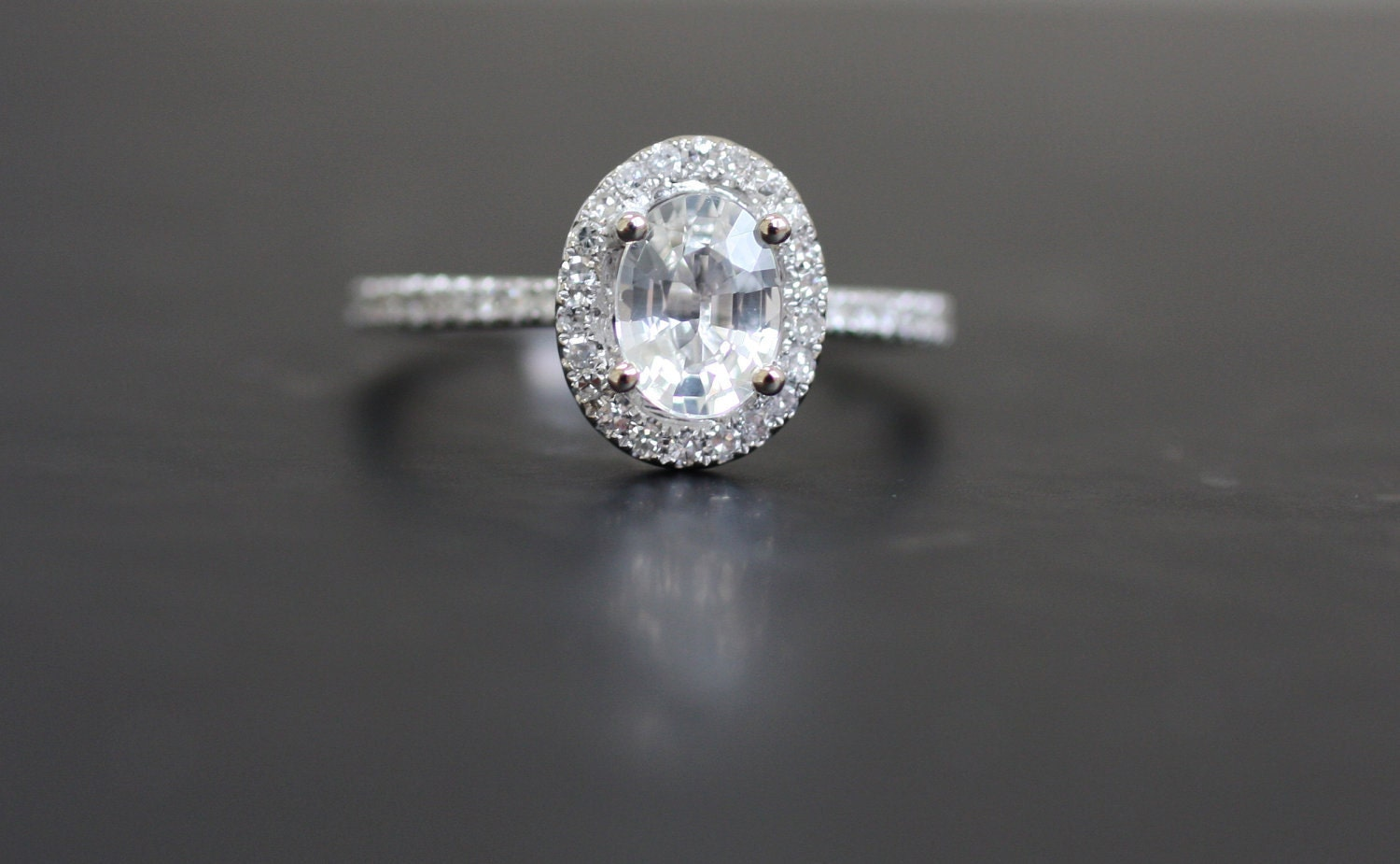 reserved oval white sapphire and white gold ring payment