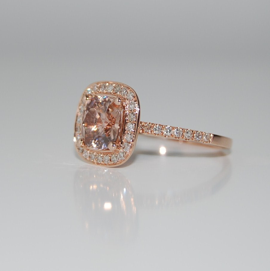 hold 2ct Cushion peach champagne sapphire in 14k rose gold
