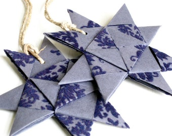 Star ornament origami folded textured dark blue Christmas