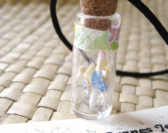 japanese chiyogami washi paper origami crane in a bottle pendant necklace by cra1nes on etsy