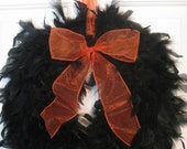 Black Feather Wreath with Orange ribbon