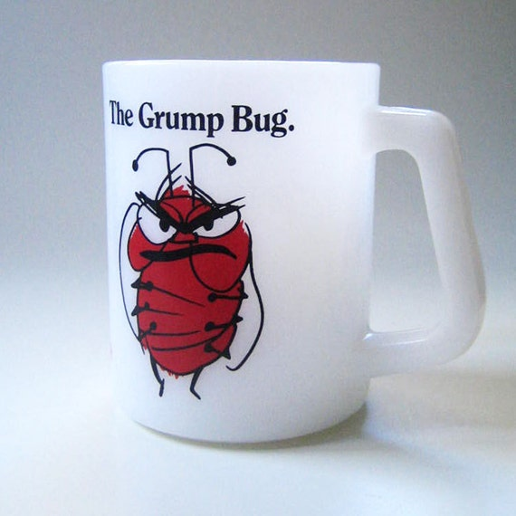Grump bug. Vintage 1960s milk glass mug, Avis advertisement.