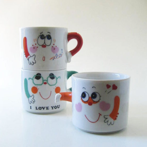 Papel Mug People, three small 1970s mugs.