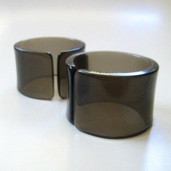 Pair of 1970s smoked plastic napkin rings.