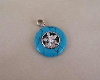 Natural Turquoise and Cubic Zirconium Sterling Silver Round Pendant.