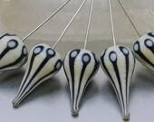 Head pins - Walking Dot teardrops (1) - ivory and black on sterling silver wire. Lampwork  by Jennie Yip