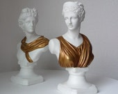 vintage man and woman statues busts