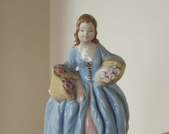 Vintage Chalkware Woman Statue with flower baskets