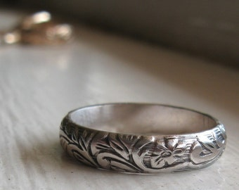 Rustic sterling renaissance wedding band with RUSH PRODUCTION.