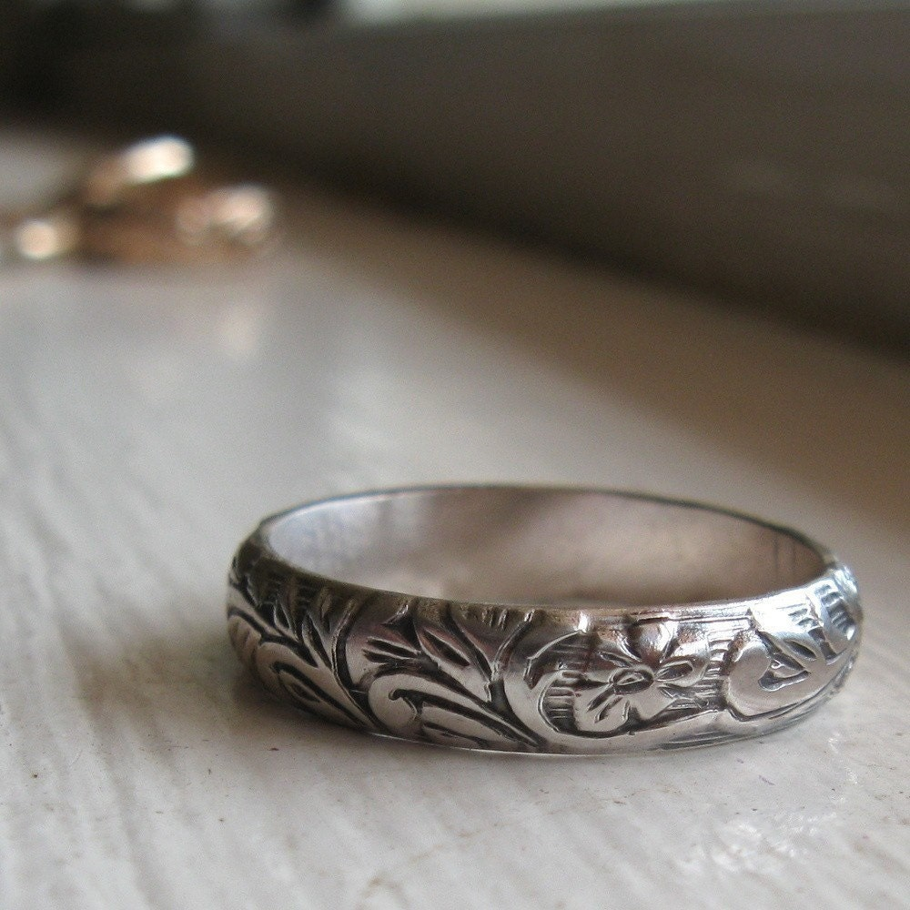 rustic sterling renaissance wedding band with production