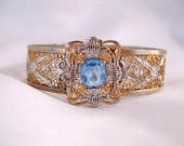 Art Deco Blue Rhinestone Silver Filigree Bangle Bracelet - J.J. White