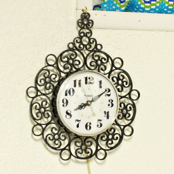 Vintage clock - wall clock - Timex - black - plastic - second hand