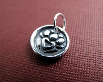 flaming heart milagro sterling silver charm