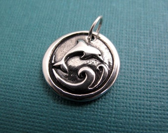 prana dolphin sterling silver charm