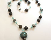 Necklace with lampwork beads, Labradorite rounds and Swarovski Crystals