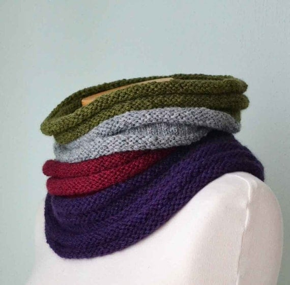 Knitted cowl in a ribbed pattern with beautiful colors