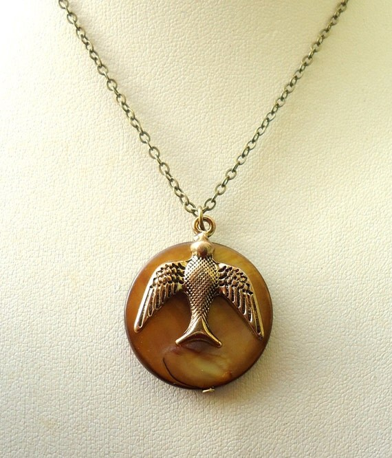 Shell Necklace with a Bird Charm