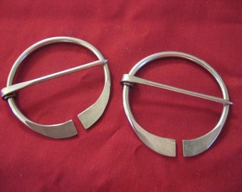 Pair of Small Stainless Penannular Brooches