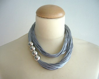 Grey necklace with silver beads