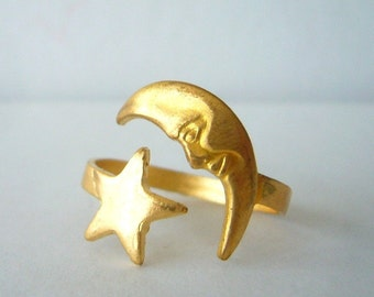 brass moon ring with a star. wrap style open ring, statement ring