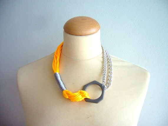 Orange statement necklace with big chain and grey touch