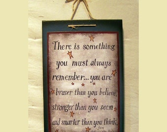 There is something you most always remember from Winnie the Pooh wood sign painted by Laurie Sherrell