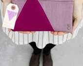 a geometric quilted zipper purse in lavender and raspberry