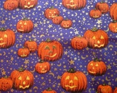 Halloween Cotton Fabric with Orange Jack-o-Lanterns on Purple with Gold Moons and Stars