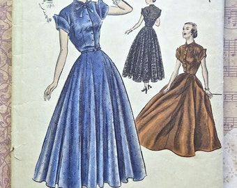 Vintage 1950s Womens Dress Pattern with Flared Skirt, Short Sleeves, and Shaped Cuffs - Vogue S-4912