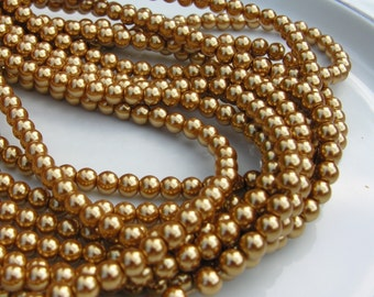 Gold 6mm Glass Round Pearls  15.5 inch strand