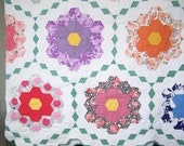 SAVEDFORjoyyounggrandmother's flower garden vintage quilt
