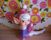pink and purple pixie elf figurine
