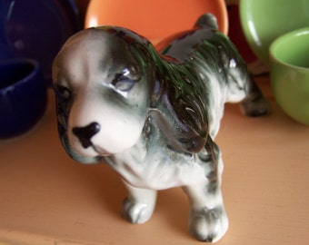 adorable grey and black doggy figurine