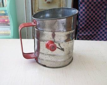 red handled vintage sifter