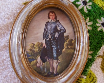 oval plastic frame with blue boy