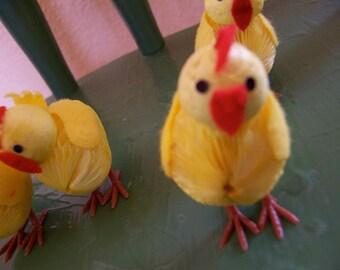 four tiny paper chicks
