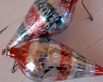 two glittery  oblong glass ornaments