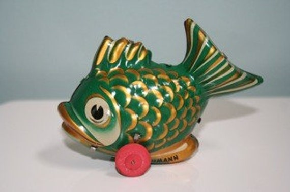 bright and lovely vintage lithographed tin Lehmann LoLo green koi wind up toy