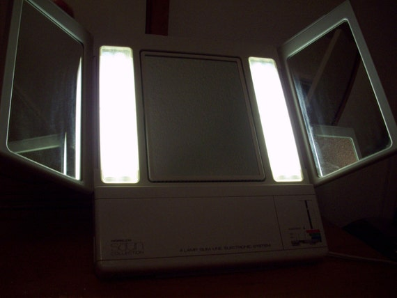 The 80s Norelco White Lighted Make Up Mirror with Multiple Settings