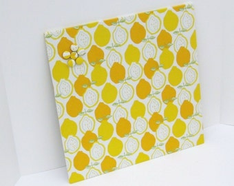 Fabric covered magnet board 16 inch x 16 inch covered in Yellow Lemon Fabric