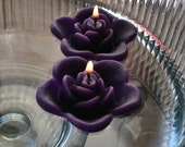 12 Purple floating rose wedding candles for table centerpiece and reception decor.
