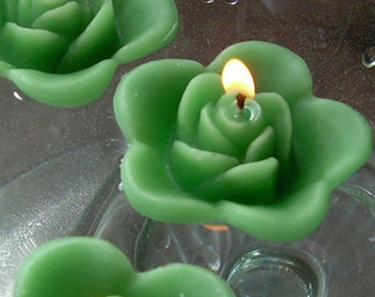 12 Clover green floating rose wedding candles for table centerpiece and reception decor.