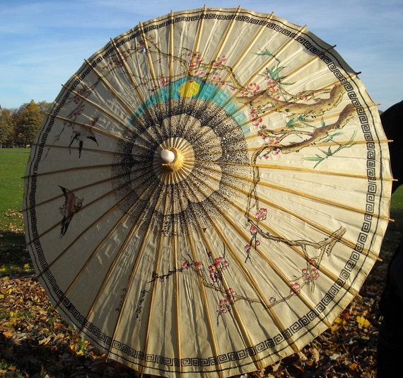 Vintage paper parasol with birds and flowers
