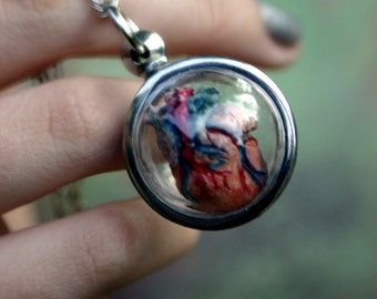 Key to my anatomical heart necklace hand-sculpted by artist Sherry Westfall Matthews