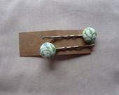 Green red and blue vine print hair slides kirby grips bobby pins with fabric covered button - a pair